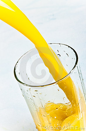 Juice is poured into a glass