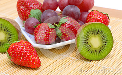 Juicy berries and fruit - kiwi, strawberries and grapes.