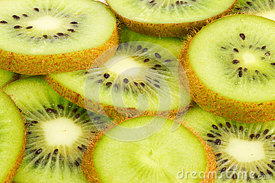 Juicy kiwi fruit slices background