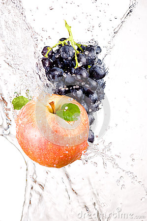 Juicy red apple and bunch of grapes in water