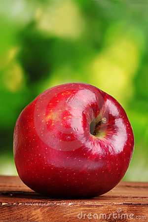 Juicy red apple on wooden