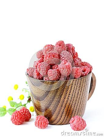 Juicy ripe raspberries with mint leaves