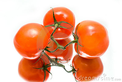 Juicy tomatoes are in a reflection