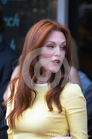 Julianne Moore and John Blake at the Hollywood Walk of Fame Cer Editorial Photo