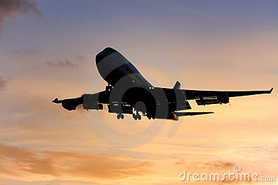 Jumbo jet airliner approaches landing.