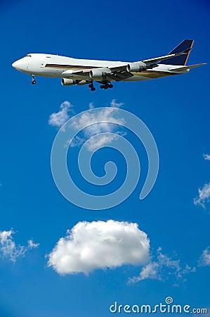 Jumbo plane and clouds