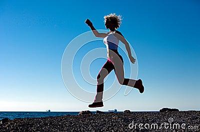 Juming Girl On The Beach While Running