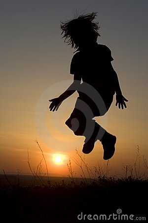 Jump of child in the sunset