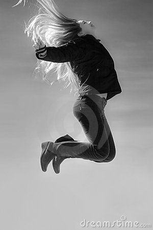 Jump of free beautiful fashionable woman