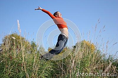 Jump girl in grass
