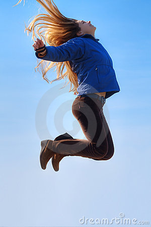 Jump of happy free woman