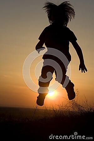 Jump of little girl - silhouette