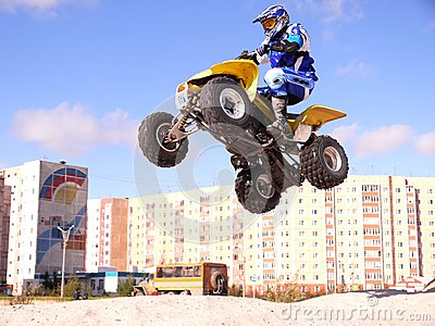 Jump on quadrocycle. Editorial Stock Image