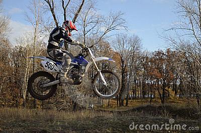 A jump rider on a motorcycle motocross