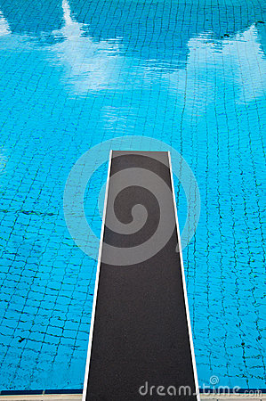 Jumping board in a swimming pool