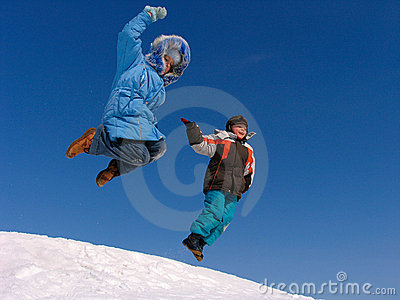 Jumping boy and girl