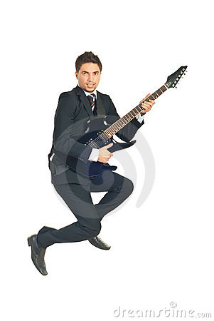 Jumping business man with guitar