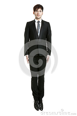 Jumping businessman, looking serious