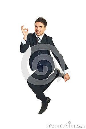 Jumping executive showing okay sign