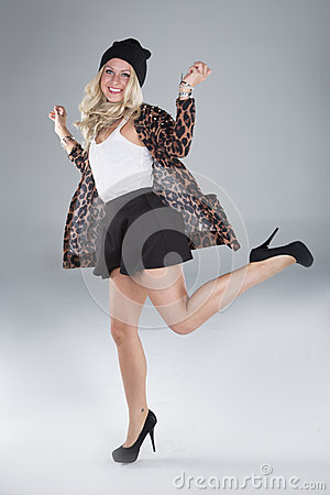 Jumping Fashion Girl in studio