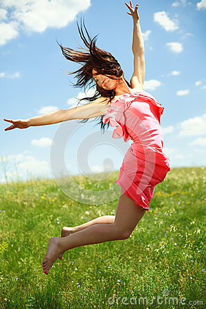 Jumping and flying graceful girl on the background of blue sky