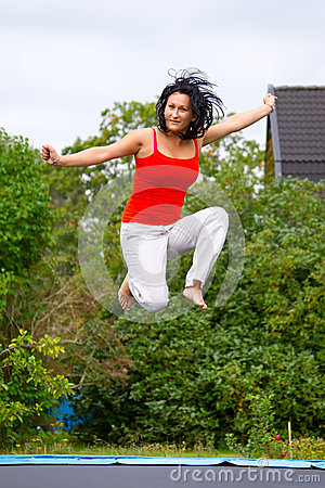 Jumping on garden trampoline