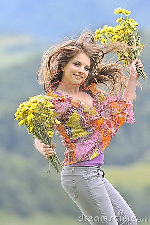 Free Jumping Girl Against Summer Meadow Royalty Free Stock Image - 23686626