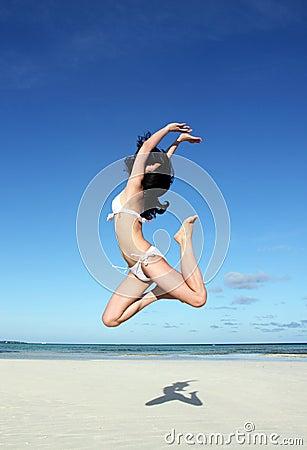 Jumping girl in bikini