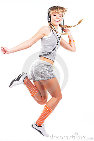 Jumping girl in headphones