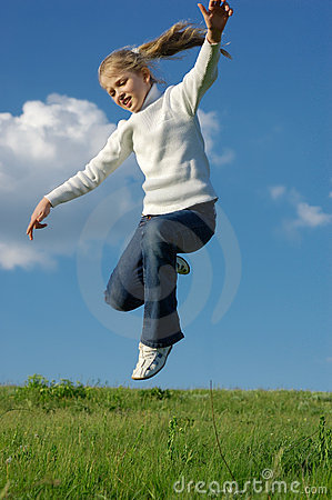 Jumping girl on meadow