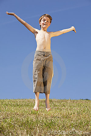 Jumping happy boy