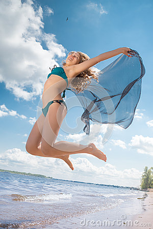 Free Jumping Happy Girl On The Beach, Fit Sporty Healthy Body In Bikini Stock Photos - 43225853