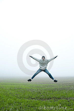 Free Jumping Jacks In Field Stock Photos - 12300553