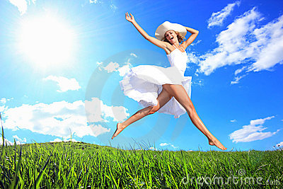 Jumping for Joy on a Grass Hill