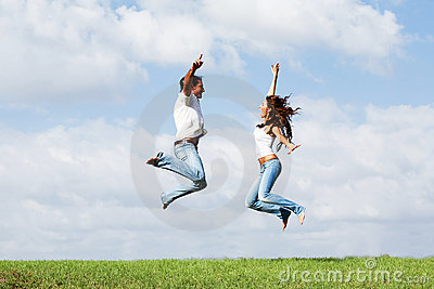 Jumping joyful couple