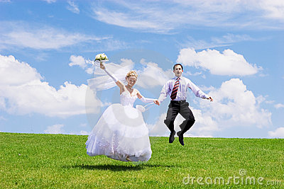 Jumping newly-married couple