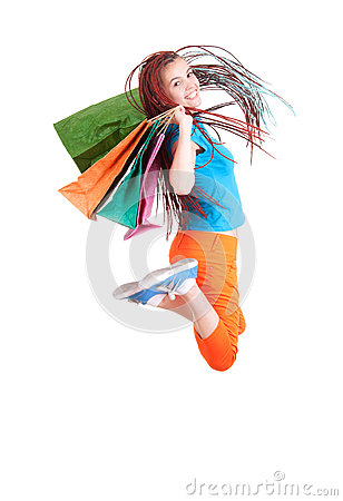 Jumping shopping girl in ethnic hairdo with bags