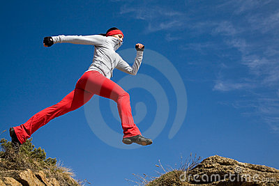 Jumping sporty woman