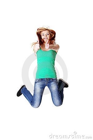 Jumping teen student showing okay gesture