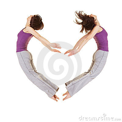Jumping woman forming heart shape