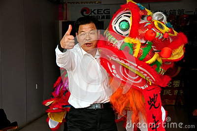 Jun Le, China: New Year Lion Dancer Editorial Stock Image