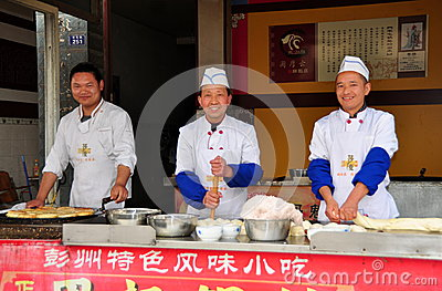 Jun Le, China: Three Chefs Making Chinese Pizzas Editorial Photo