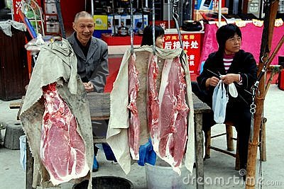 Jun Le Town, China: Butchers Selling Pork Editorial Photo
