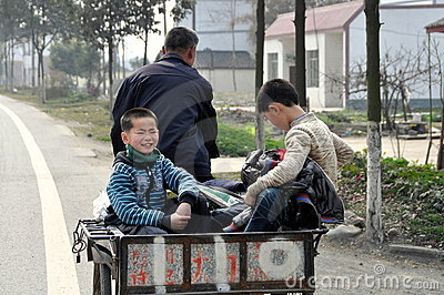Jun Le Town, China: Two Little Boys in Cart Editorial Stock Photo