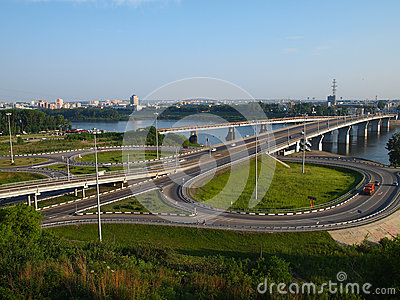 Junction of roads with two rings and a bridge