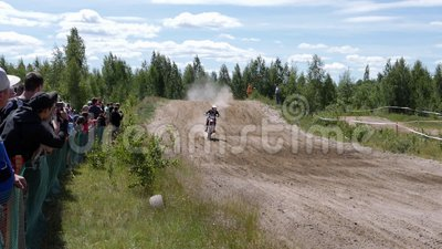 June 10, 2018 Russian Federation, Bryansk region, Ivot - Extreme sports, cross motocross. The motorcyclist enters the. Turn on the race track. Dirt is flying stock video footage