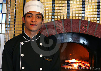 Junior chef at pizza restaurant