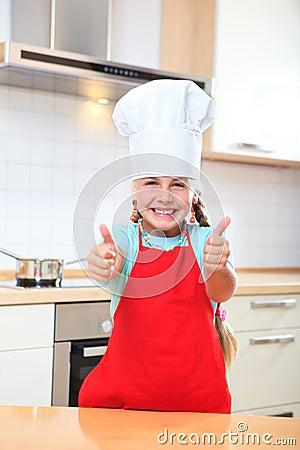 Junior cook thumbs up