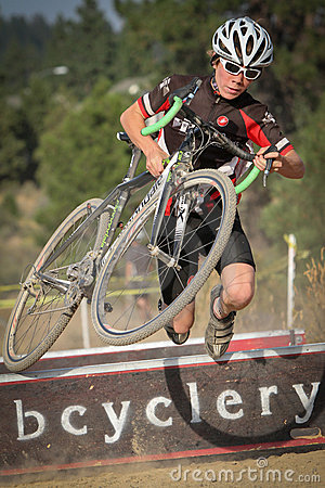 Junior Cyclocross Racer Trips Over Barrier Editorial Photography