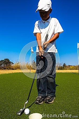 Free Junior Golf Putting Royalty Free Stock Image - 34923956